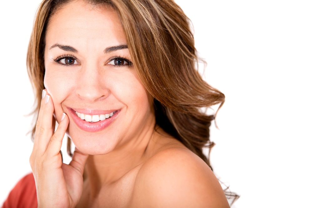 Beauty female portrait smiling - isolated over a white background.jpeg