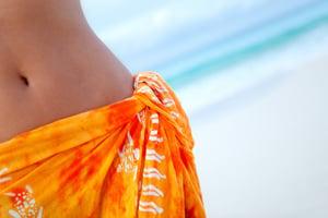 beautiful woman wearing a sarong at the beach