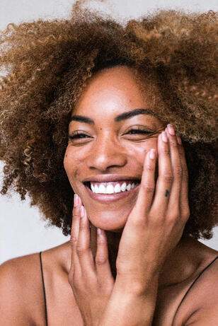 woman-happily-touching-face